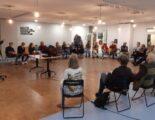 Deelnemers van het Klimaatcafé in een zaal